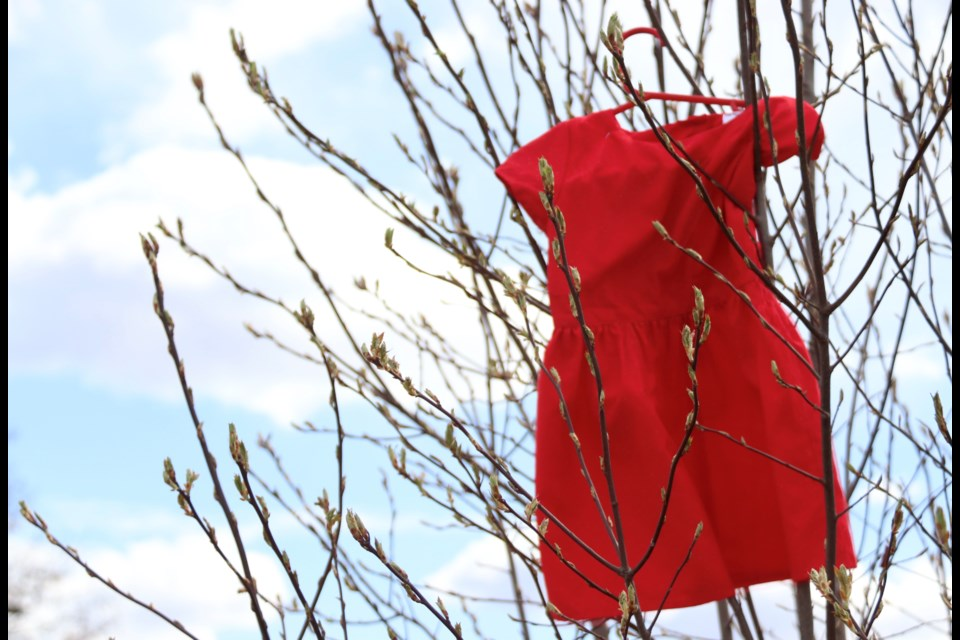 Red dresses were blowing in the breeze during the Missing and Murdered Indigenous Women and Girls event.