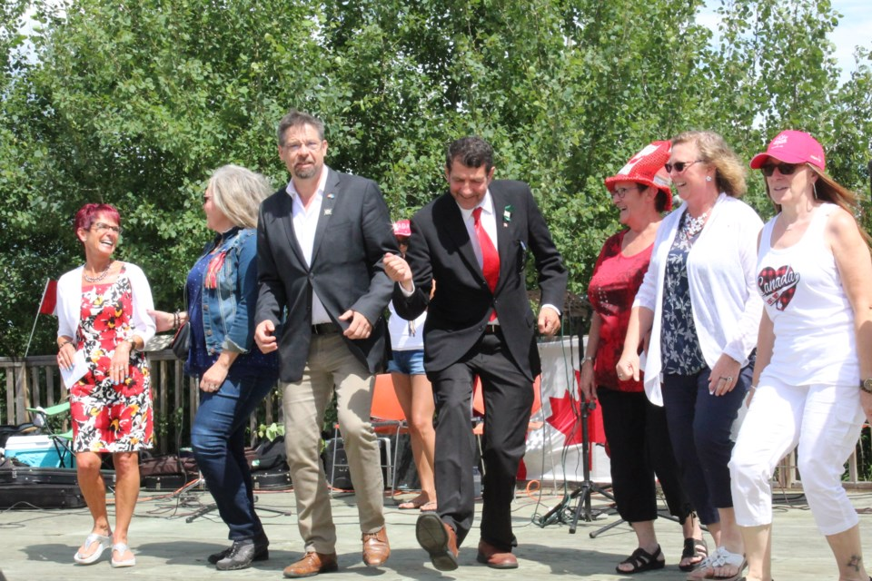 Lac La Biche County Mayor Omer Moghrabi — when his hip was better — dancing at a 2018 Canada Day celebration with officials including MP David Yurdiga. Moghrabi says fun times like these in his own community  are better than any holiday at any time of the year.       Rob McKinley file photo