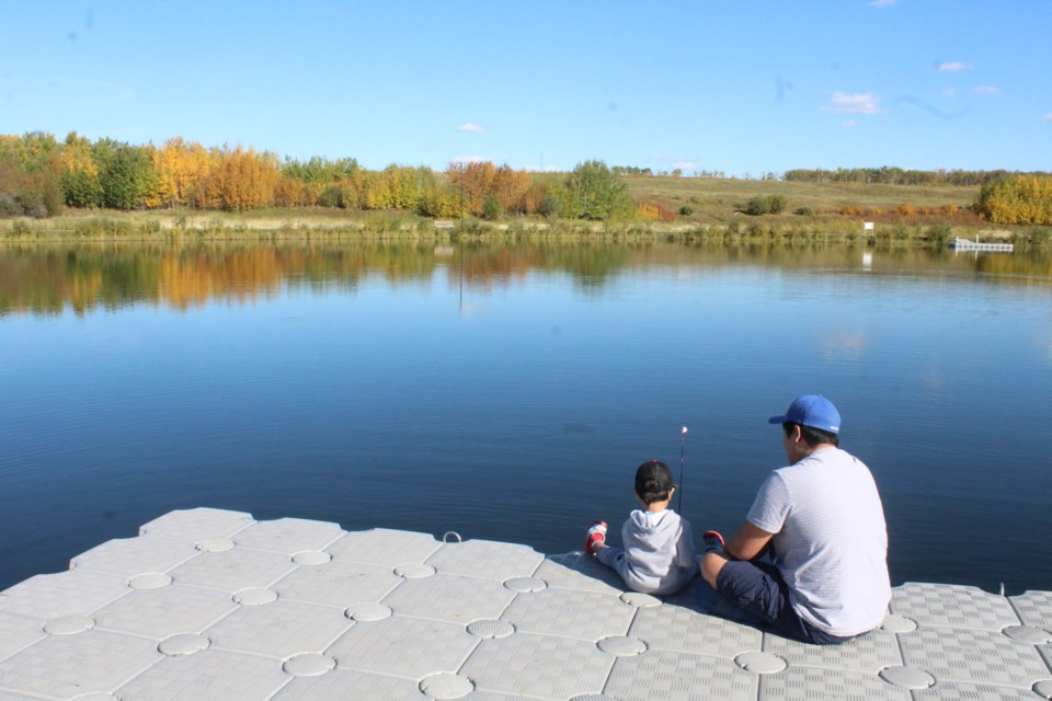 Jay Ignacio and his two year-old son John-Cedrick we're enjoying some fishing and fall colours at Lac La Biche's Alexander Hamilton Park Tuesday afternoon.      Image Rob McKinley