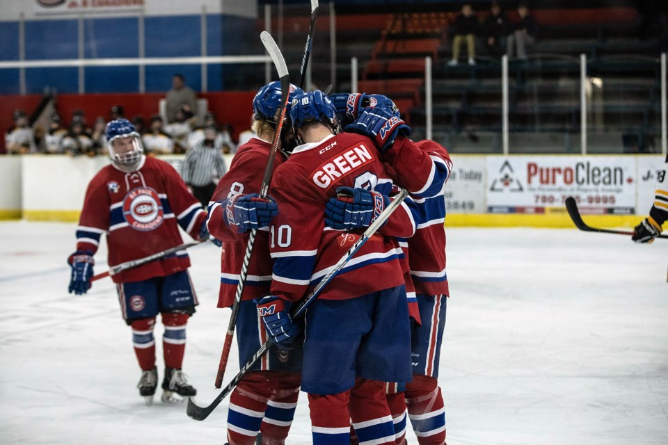 The Canadiens celebrate one of their first goals of the night on Oct. 30, at the Clancy Richard Arena. Janice Huser photo.