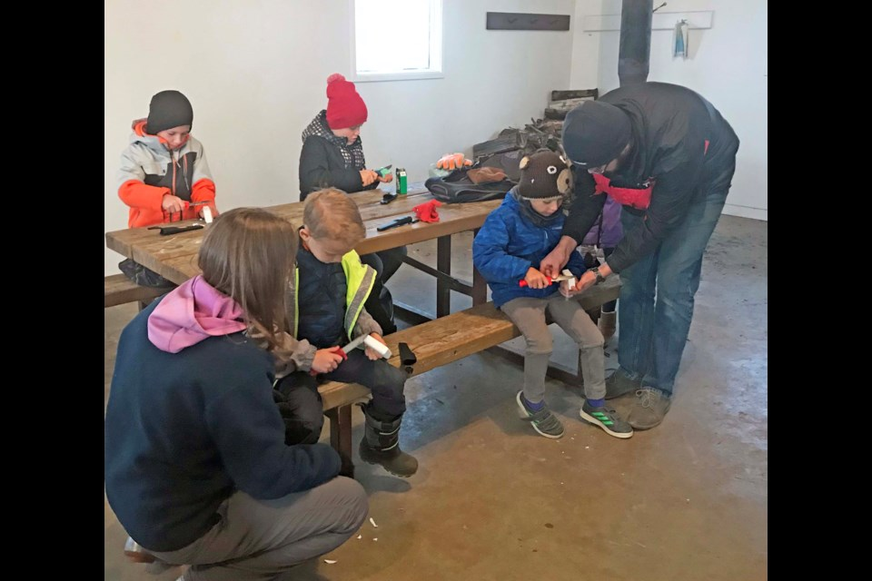 Youngsters enjoy some hands-on knife-safety skills during Friday's Junior Forest Warden meeting in the camping shelter at the Beaver Lake group use site. The Junior Forest Warden program is starting up for another year in the Lac La Biche area, teaching youngsters outdoor recreation skills and environmental lessons. For more info on the program and to register: www.ajfwa.ca         Image Jana McKinley