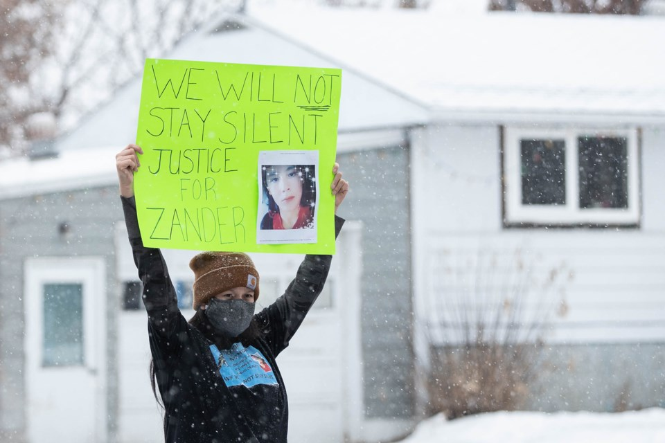 Family members of homicide victim Zander Jackson stood in front of the St. Paul Courthouse on Thursday, the scheduled date for the first appearance of the two men accused of second degree murder. Janice Huser photo
