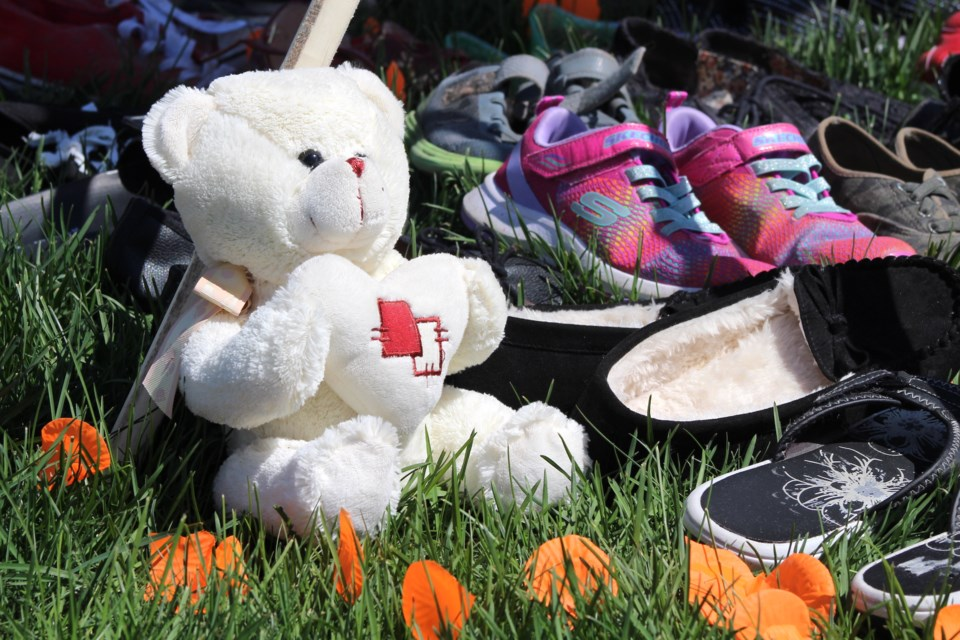 A memorial that included shoes and stuffed animals was set up. Photo by Robynne Henry.