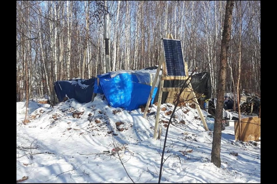 An image of the Lac La Biche encampment located in a downtown wooded area on privately-owned property.  Image suppled Lisa Marie Bourque