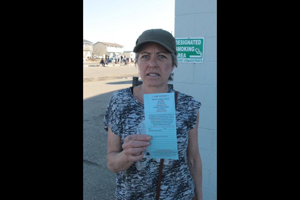 Laurie Mulgrew, a recent Kikino resident was at the rally to show support for human freedoms. She holds her own, homemade mask exemption card she created from global and federal information.