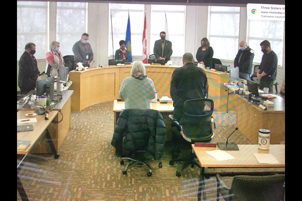Metis Nation of Alberta President Audrey Poitras (centre-left) and MNA Region 1 President Jim Cardinal (centre-right) stand with Lac La Biche County council as an Indigenous prayer is read to start Wednesday's special council meeting about a short-term solution for some local homeless residents.