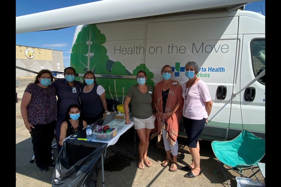 Local nursing staff on hand to provide easy access to first and second dose COVID-19 vaccinations in St. Paul at the AHS mobile health van Wednesday were (left to right): Cindy Briggins, Nicole Blais (kneeling), Alyanna Cayanan, Morgan Yurkowski, Kim Reszel, Carmen Gerlinsky and Becky Lupul.
