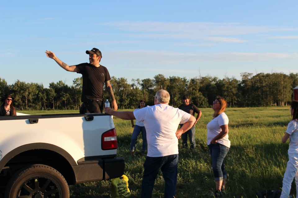 Director Travis Nesbitt explains to the extras what they're going to do for the Lie to Me music video shoot in Bonnyville on Saturday, July 24.