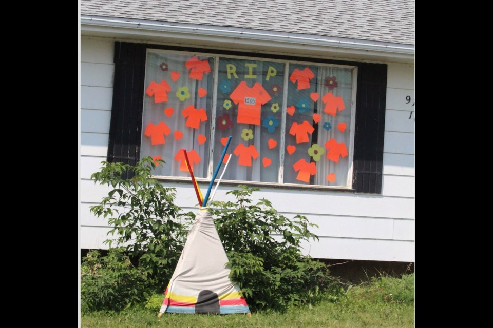 The front of Nicole Cardinal's home on 103 Street and 94 Avenue in Lac La Biche has attracted attention to Canada's historic residential school tragedy.