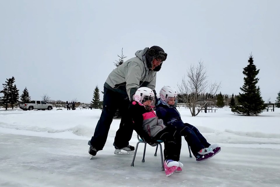 The Bernier family enjoys the new outdoor skating oval.