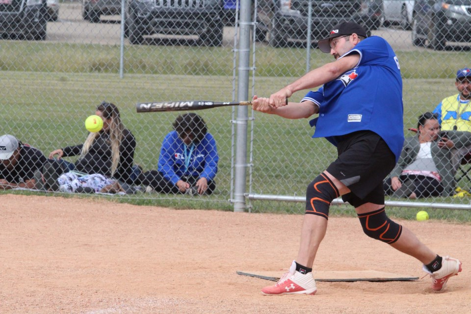 Jimmy Nashim hits a line drive during his team's Saturday afternoon game on the Plamondon diamonds.