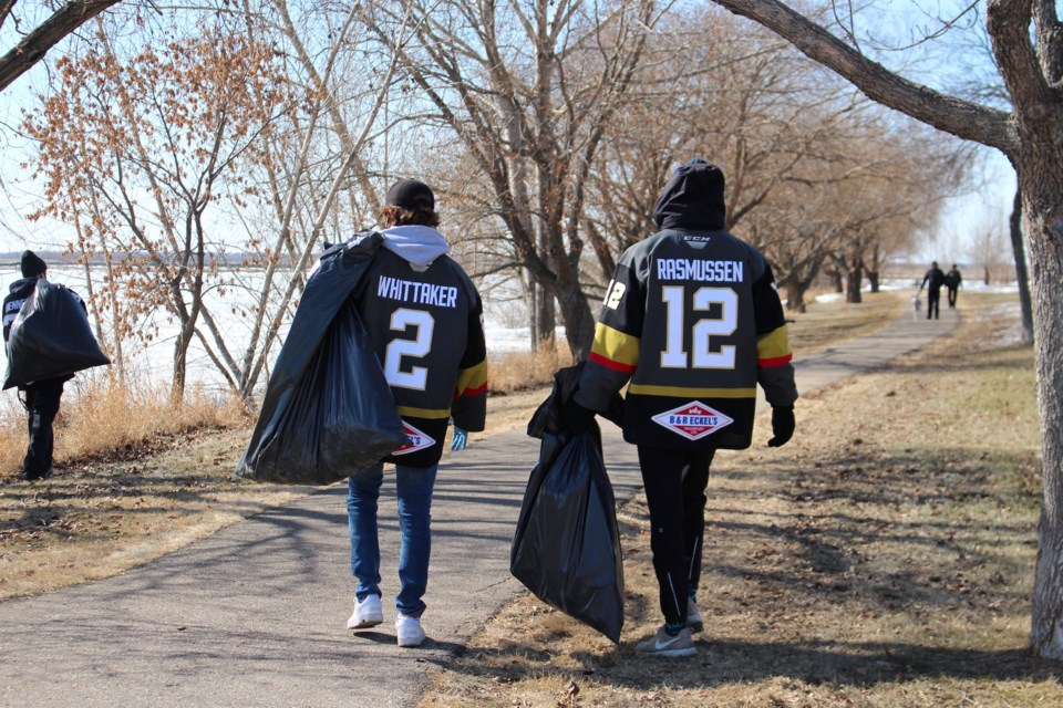 The Bonnyville Jr. A Pontiacs traded in their skates and hockey sticks for plastic gloves and garbage bags, picking up litter around town on Monday, March 23. Photo by Robynne Henry.