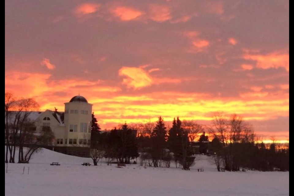Wish you were here: Lac La Biche County's civic offices at McArthur Place look like a postcard setting during a recent northern Alberta sunset.        Image Rob McKinley
