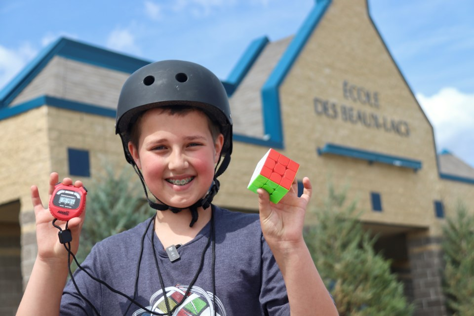 Leland Warburton has unofficially broken a world record at just the age of 11. The Bonnyville youth solved a Rubik's cube while operating a hover board in 19 seconds, besting the current world record of 30 seconds.