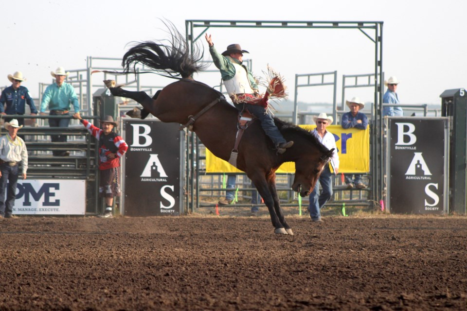 Ky Marshall held on during the bareback riding event at the Bonnyville Pro Rodeo on Friday, July 9.