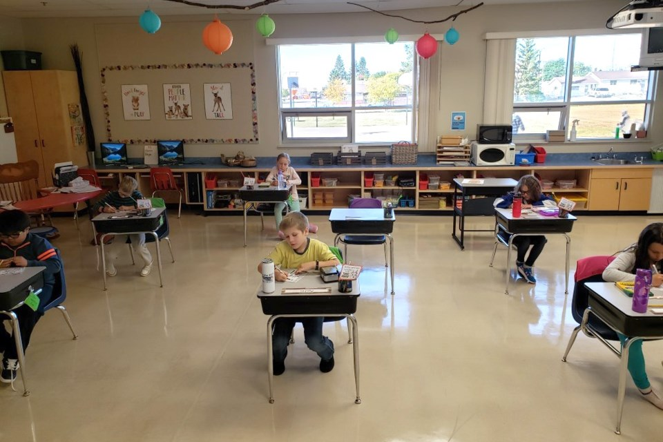 Students at Two Hills School are seen in their classroom, with desks spread apart, in this photo from last September's school start-up.