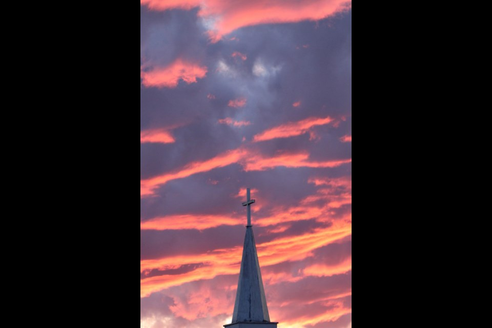 The clouds reflecting the last rays of Wednesday's sun over Lac La Biche gave the St. Andrew's Anglican Church steeple a heavenly backdrop.
