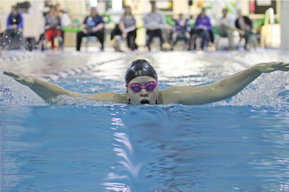 Whitecaps swim team member Hanah Shulz at a recent swim-a-thon at Lac La Biche's Portage Pool. The existing aquatic centre's pool is too short to host official swim meets. A new pool would attract swim events from around the province.      Image Rob