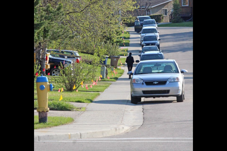 Utility flags line a Dumasfield street near Beaverhill Road as fibre-optic cable is prepared to be offered to area residents.