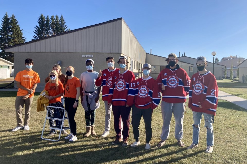 Five members of the St. Paul Jr. B Canadiens and five members of the Youth Council helped clean windows at Heritage Homes Phase II, Sept. 29.
