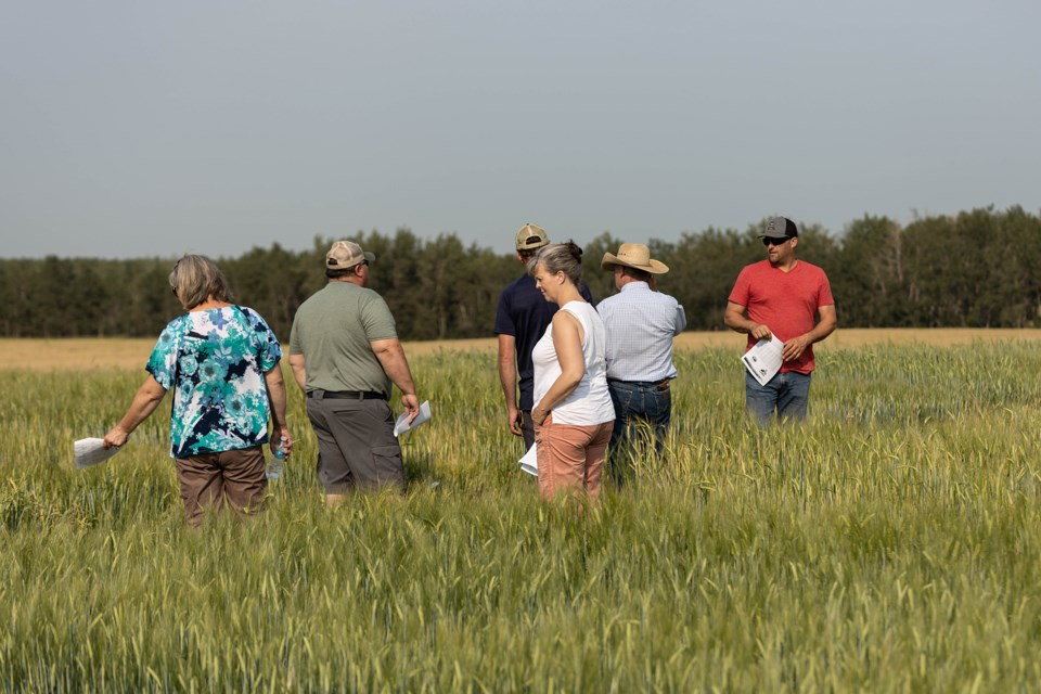 Participants and LARA representatives take part in a field tour along Highway 28, near Mallaig on Aug. 5.