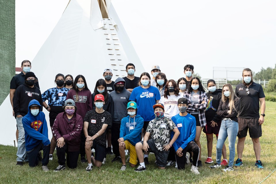 Youth and instructors at the Hi-Tek multi-sport camp are pictured behind the BGC in Saddle Lake.