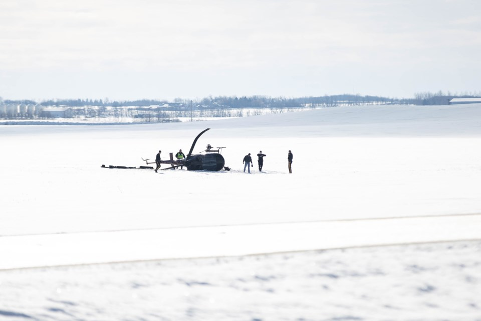 Emergency crews on scene at a helicopter crash, east of St. Paul, Feb. 24.