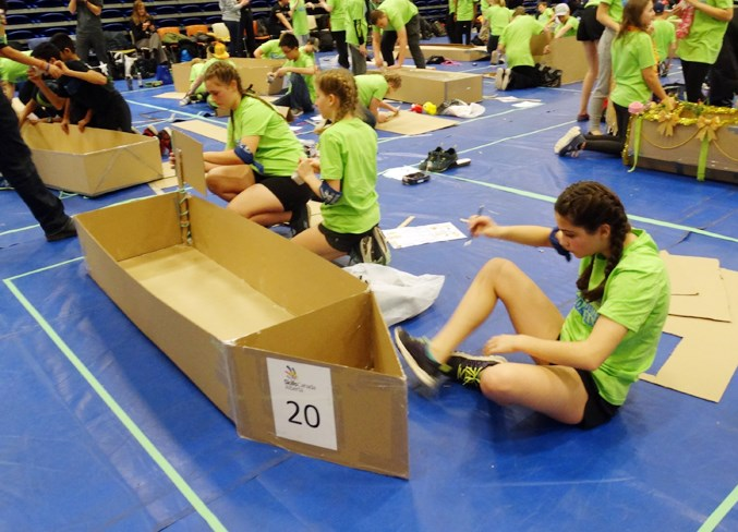 Students from H.E.B. show off their boat building skills.
