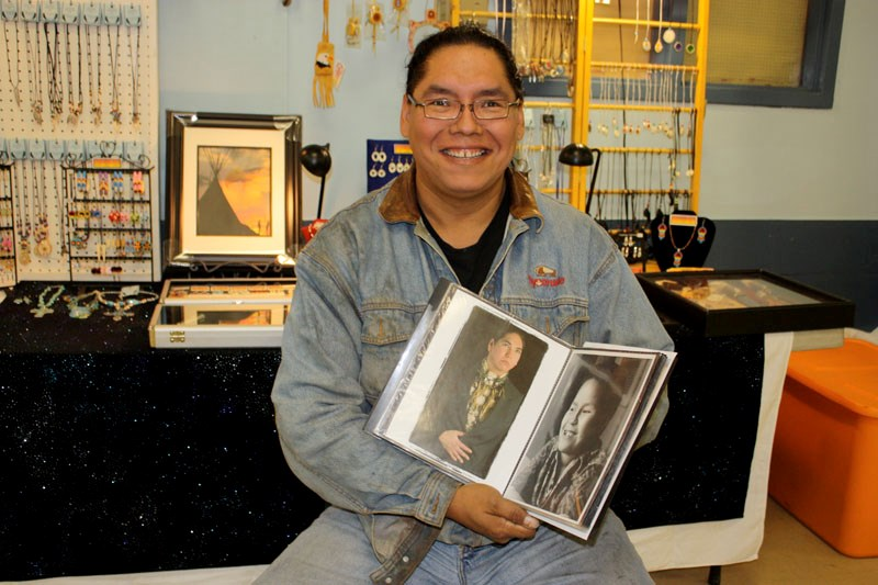 Samuel Bull displays some of his photography at the Fall Harvest fair in Goodfish Lake on Sept. 20.