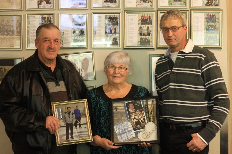 Aime and Yvonne St. Arnault presented a picture of their son Richard, who passed away last year, to Mallaig curling club president Marc Michaud. The picture of Richard will