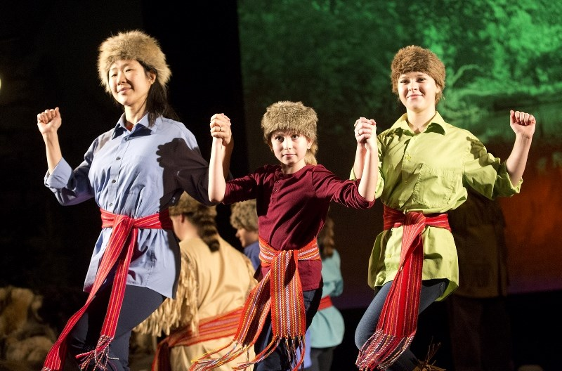 Lynda Young (left), Megan Pashko (centre), and Emma Robertson (right) perform a dance during the Oct. 26 rehearsal for the '150 years: Canada Yesterday, Today,