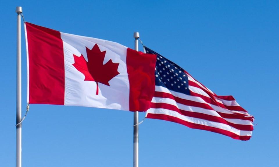 o-CANADA-UNITED-STATES-FLAGS-facebook-1140x684
