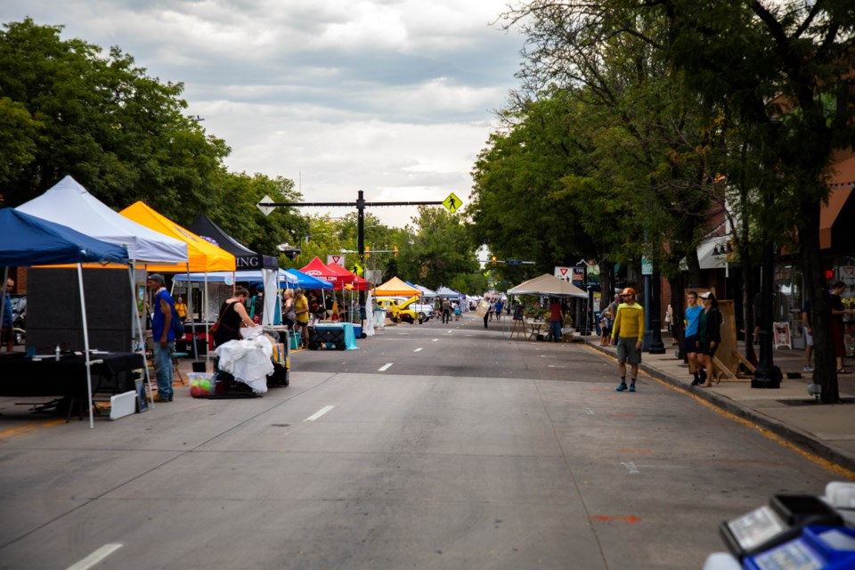 Though a few scattered drops graced the evening, the crowd gathered to celebrate ArtWalk and Longmont's 150th Anniversary.