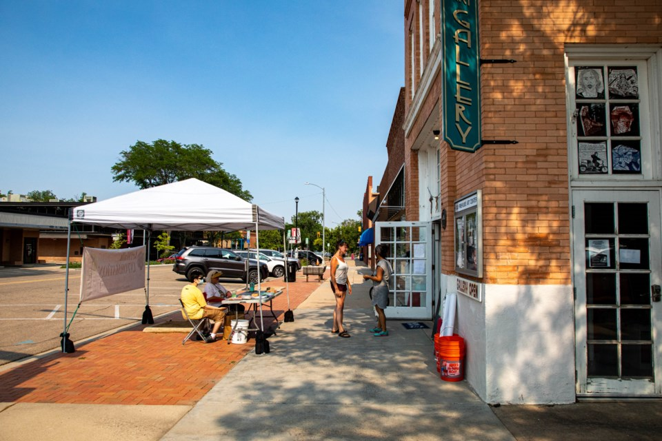 The second weekend of ArtWalk's Summer on the Streets filled the breezeways and alleys off Main Street with artists, vendors and musicians.