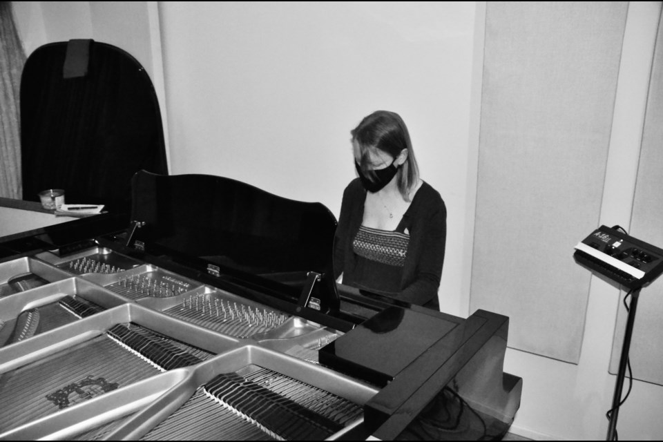 """Jessica Carson in the studio recording """"Things Worth Remembering""""  Photo by Jordan Bass"""