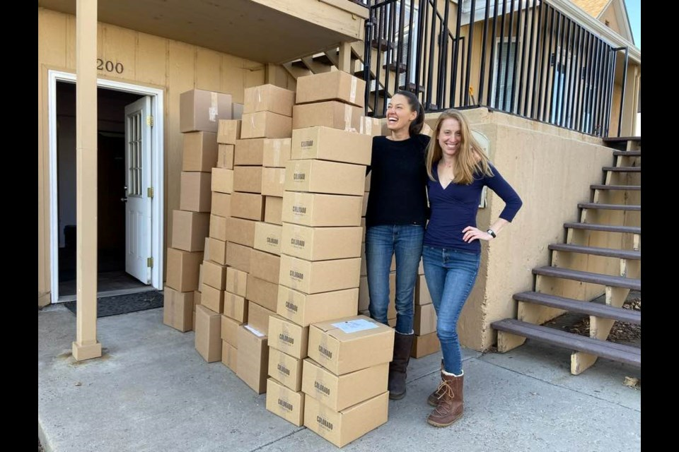 Sarah Welle (L) and Dulcie Wilcox in 2019, in front of outgoing gift boxes