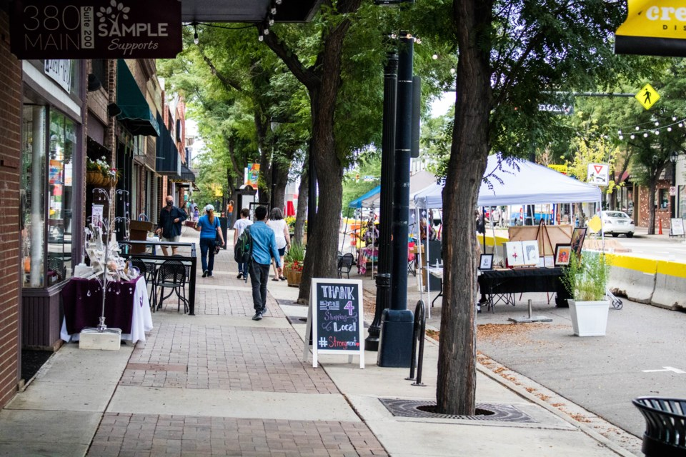 Shoppers browse Main Street businesses on July 25, 2020.