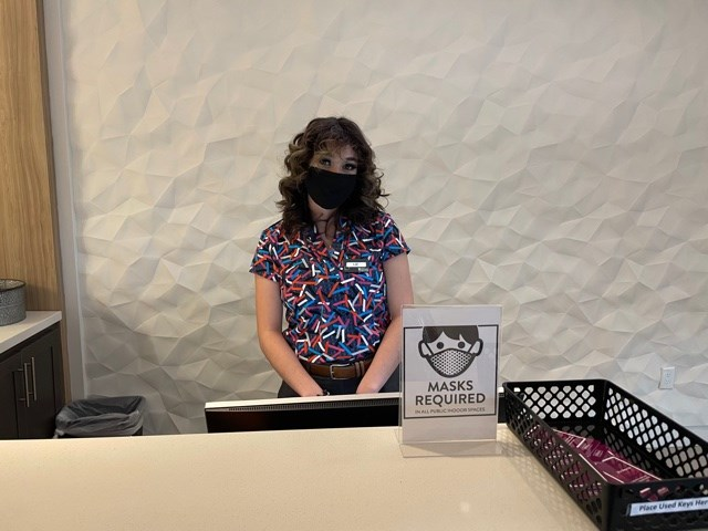Liz Guillemont attends the front desk waiting to welcome hotel guests