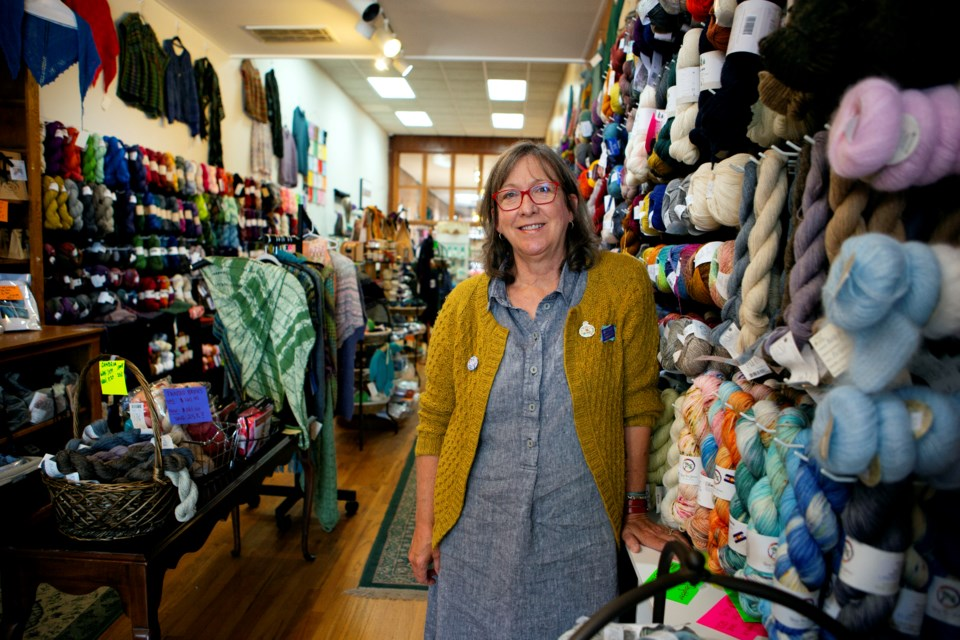 The Longmont Yarn Shoppe owner Gail Sundberg-Douse stands by the yarn sold in the downtown store on July 8. Photo by Ali Mai | ali.mai.journo@gmail.com