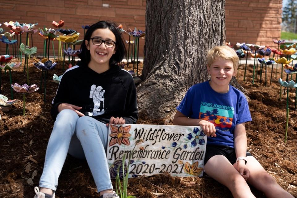 Lyons Elementary School's fifth grade students Amanda Gonzalez and Birch Eyster at the school's Wildflower Rememberance Garden installation on May 13, 2021 | Photo by Caroline Chutkow