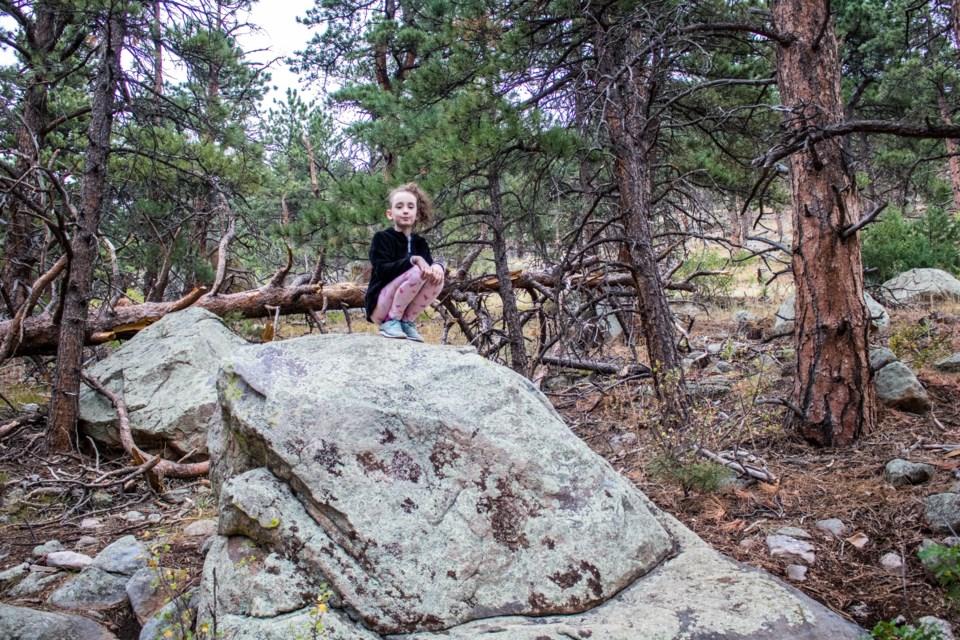 Freya enjoys the view from atop a boulder along the Lichen Loop. (Photo by Matt Maenpaa)