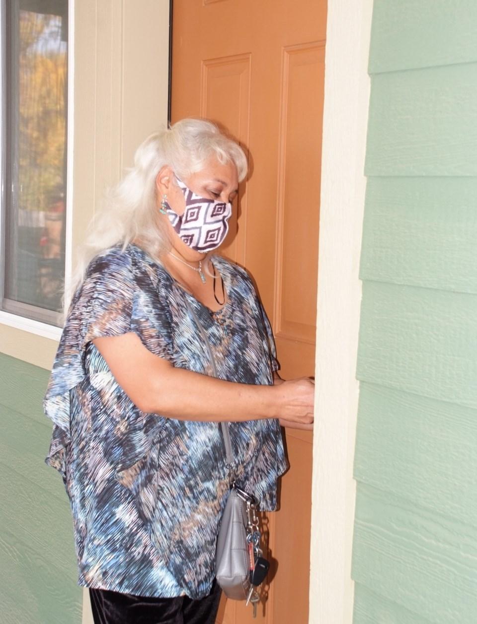 Ana Murango opens door to her first home.