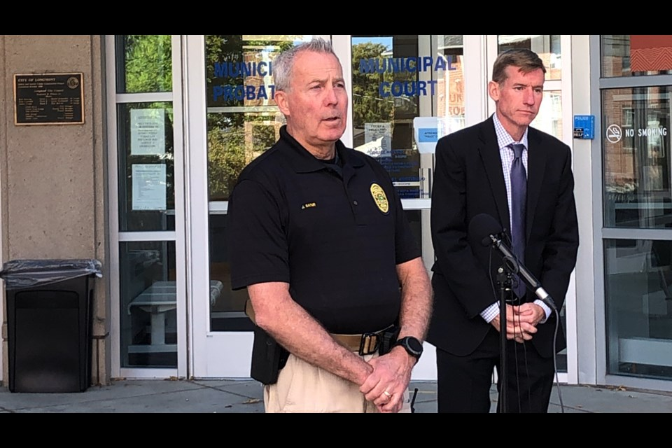 Deputy Chief of Police Services Jeff Satur and Boulder County District Attorney Michael Doughtery share information about the shooting of a postal worker in southwest Longmont during a press conference