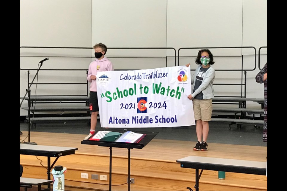 Altona Middle School's seventh grade students, Ben Barnett and Brynn Rothstein, on stage during the banner ceremony announcing the school's designation as a 2021 Colorado Trailblazer Schools to Watch on May 13, 2021   Photo by Silvia Solis