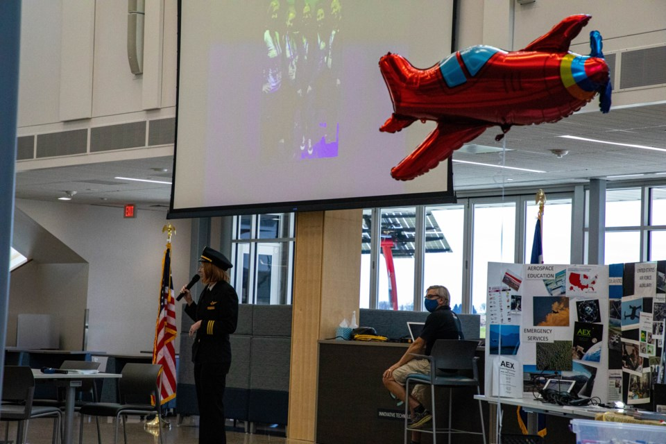 Delta Airlines Pilot Nancy Hultgren speaks to the group about commercial airline piloting.