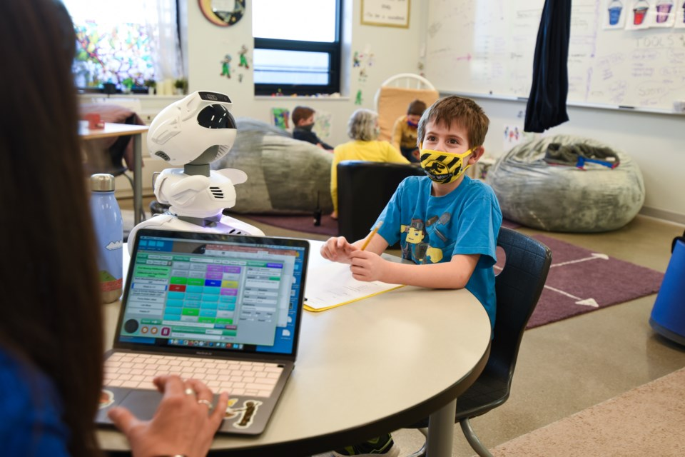 Larrissa Mangione, Soaring Heights PK-8 Affective Needs Teacher, with Misty robot and student Robert Tussey | Courtesy photo