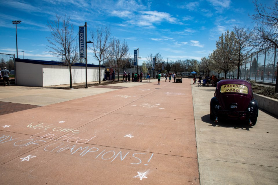 Messages of welcoming and encouragement in chalk on the pavement at Longmont High School