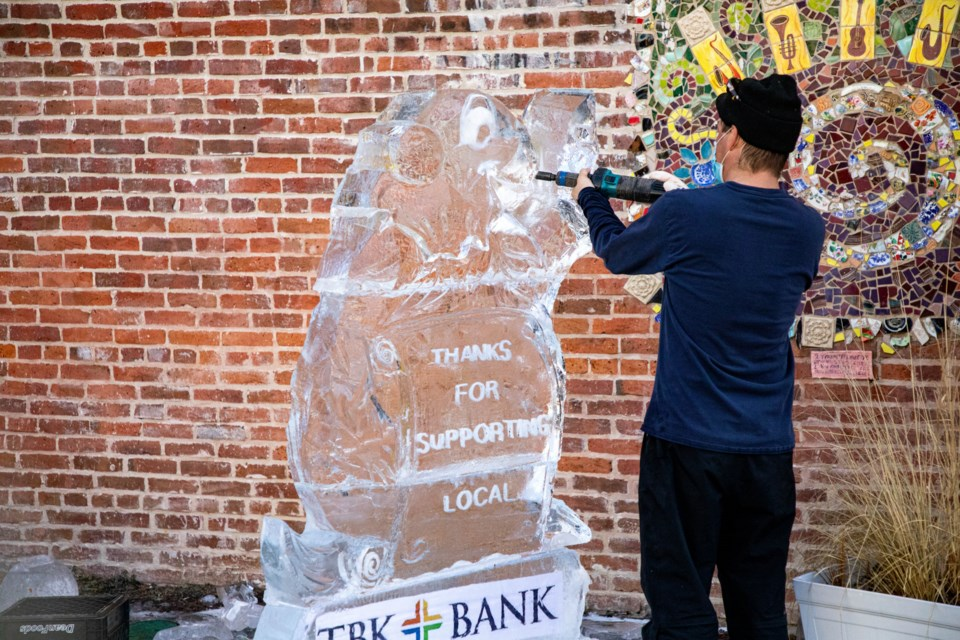 Jess Parish of Cool Hand Ice carves a 1,200-pound groundhog sculpture at St. Stephen's Plaza in Longmont on Tuesday, Feb. 2, 2021.
