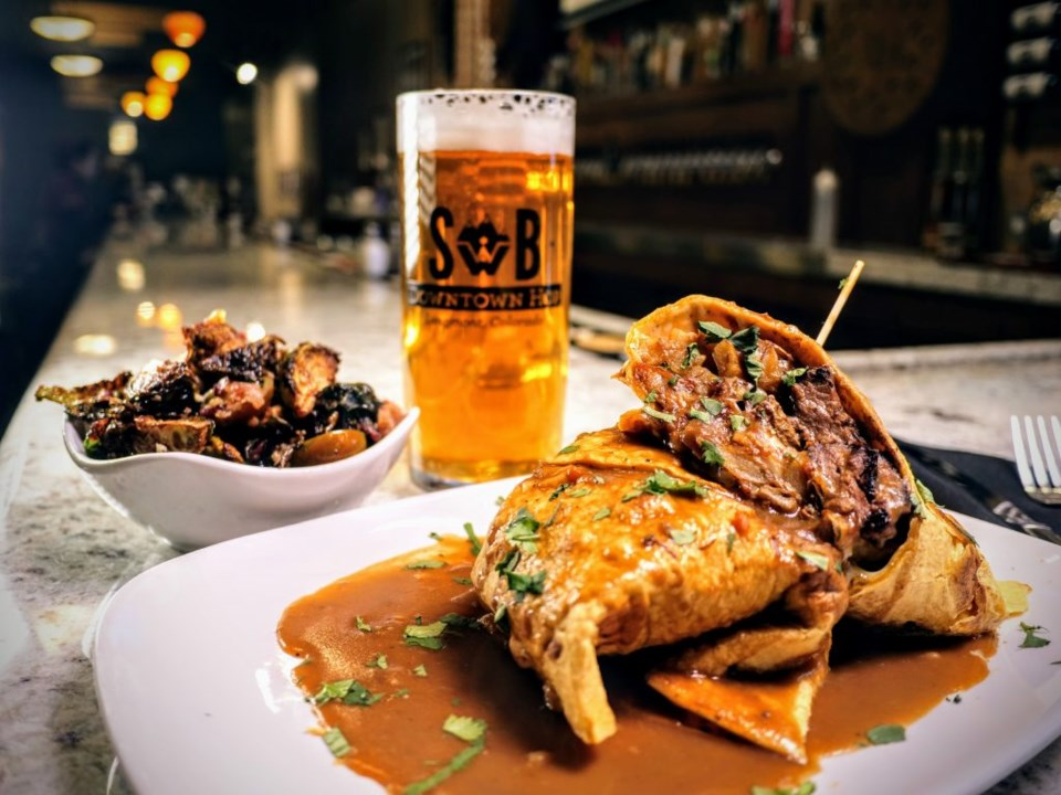 Poutine Burrito, brussel sprouts, side, and Downtown Hop beer