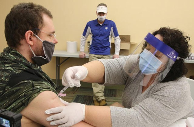Youngstown City Health District nurse Theresa Sanchez administers a dose of the coronavirus vaccine to Joseph Taylor, a Gateways to Better Living group home resident, during a city-run vaccination clinic Thursday at the Eugenia Atkinson Recreation Center in Youngstown.